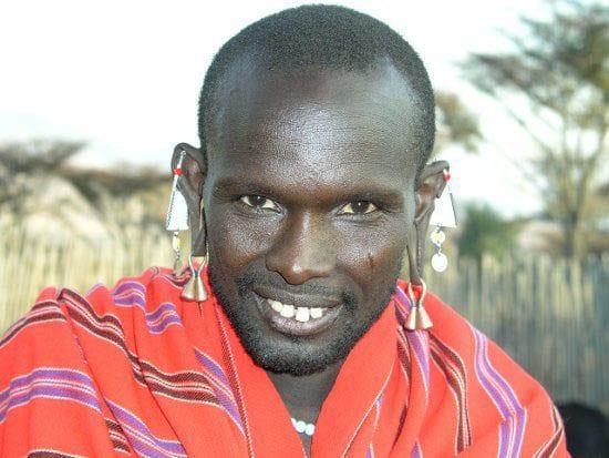 Weekly Photos: Decorated Masai Warrior & Family