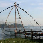 """Chinese fishing nets dot the shores of Fort Cochin"""