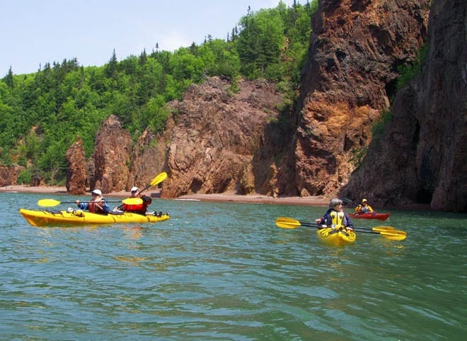 """Kayaking past red cliffs and fantastic rock formations"""