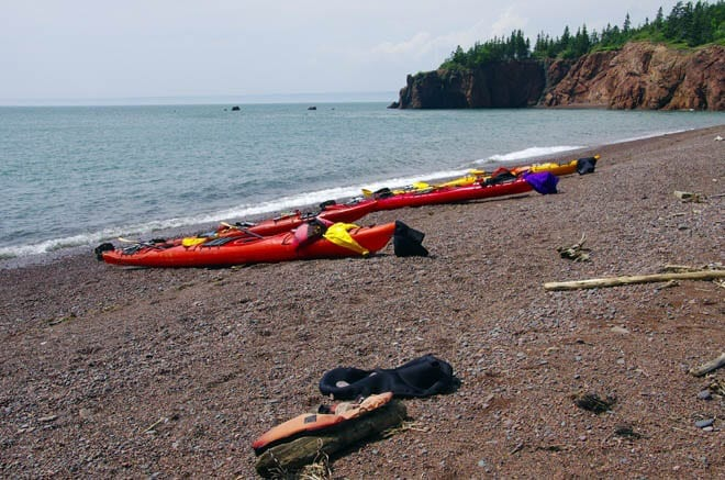 """Our two man kayaks pulled up on the beach"""