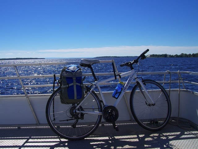 """It's just me and my bike on the ferry to Peribonka"""