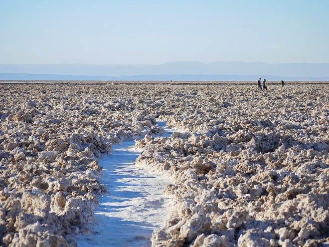"""Walking on salt to the salt flats in the Atacama Desert"""