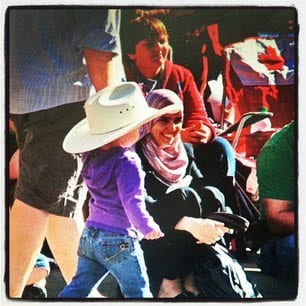 """A little girl in purple at the Calgary Stampede"""