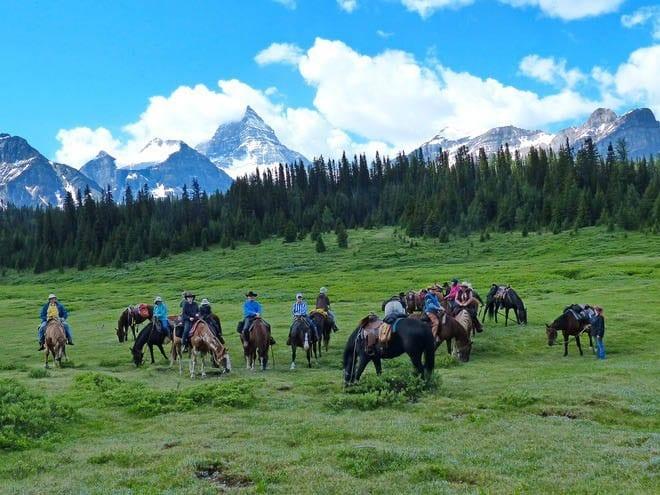 """Horseback riding in the Rockies"""