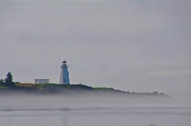 """Lighthouse in the fog"""