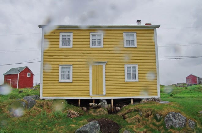 """Yellow house seen through a rainy lense"""