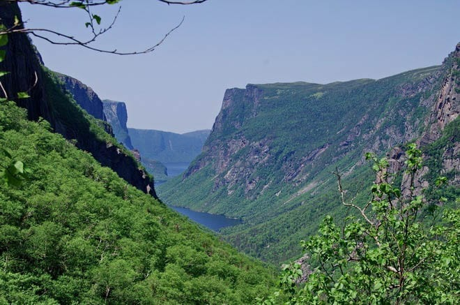 """Peek a boo views of Western Brook Pond after a steep section of hiking past the waterfall"""